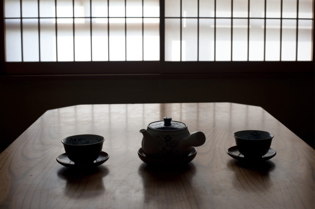 japanese tea pot and cups set out ready to enjoy a cup of green tea